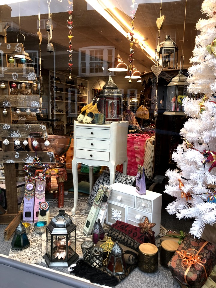 shop front with white tree , ornaments and small items of furniture