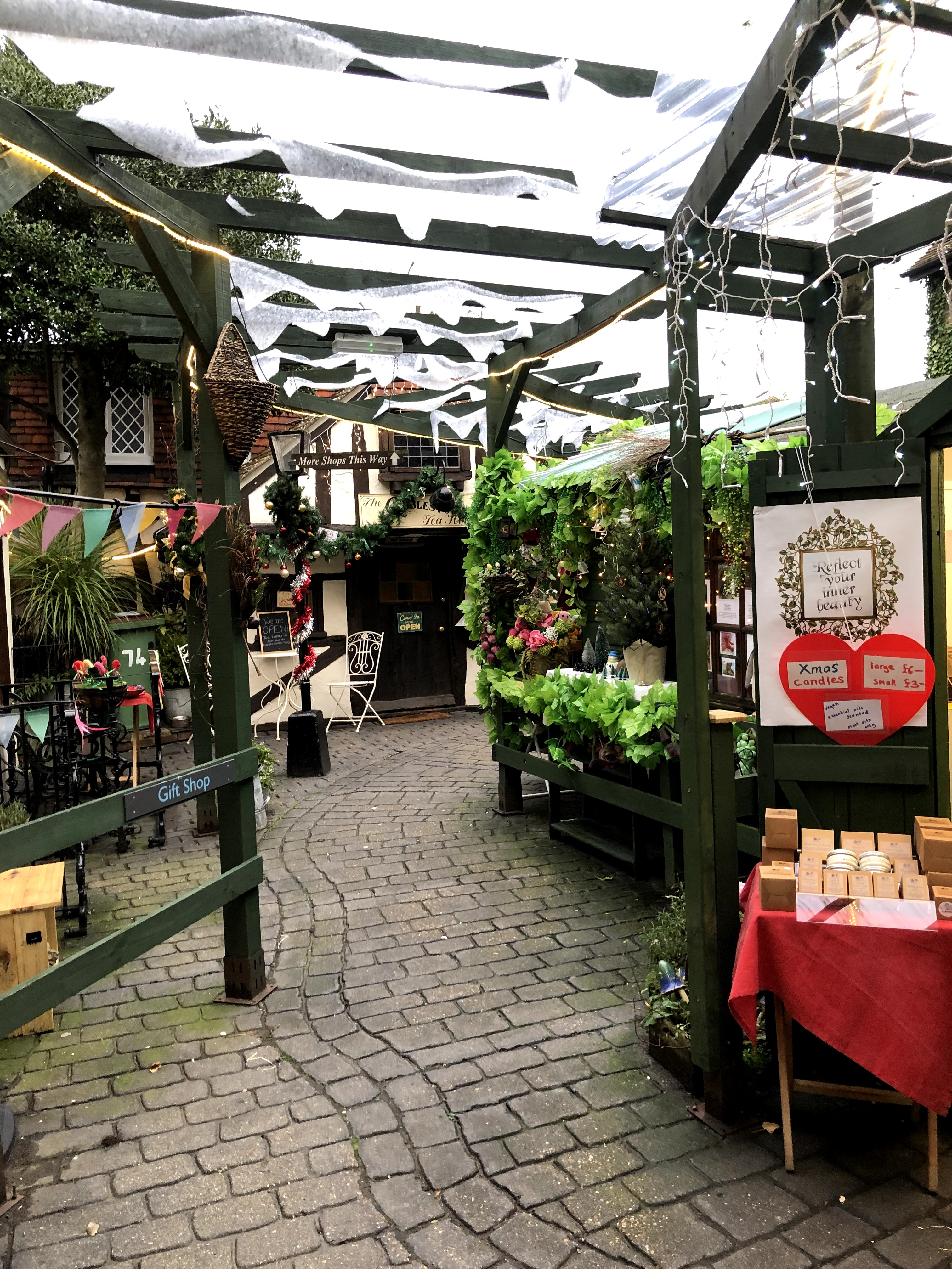 photo of small paved pathway between huts in a quaint shopping area