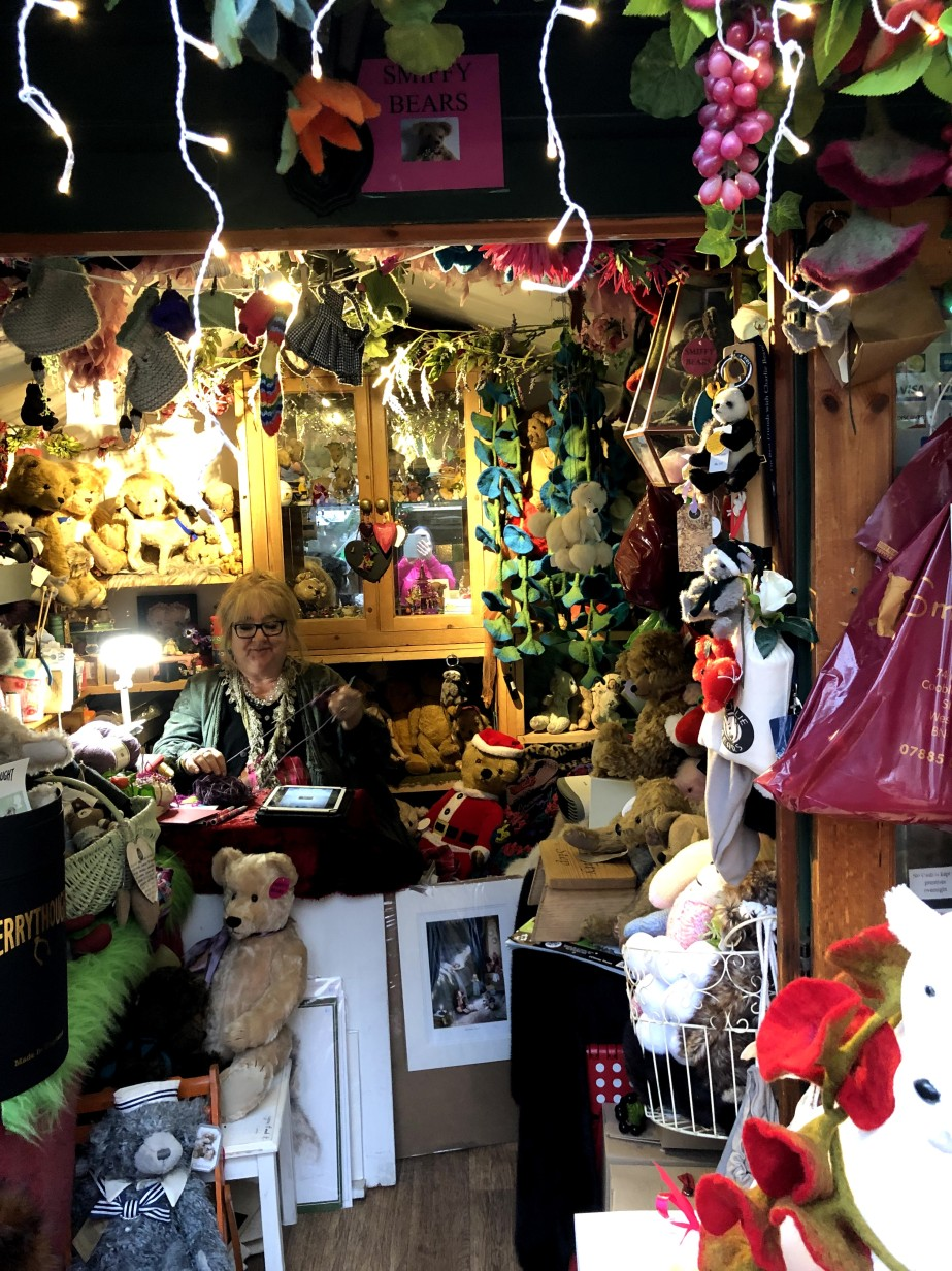 shop with teddy bears and shop owner