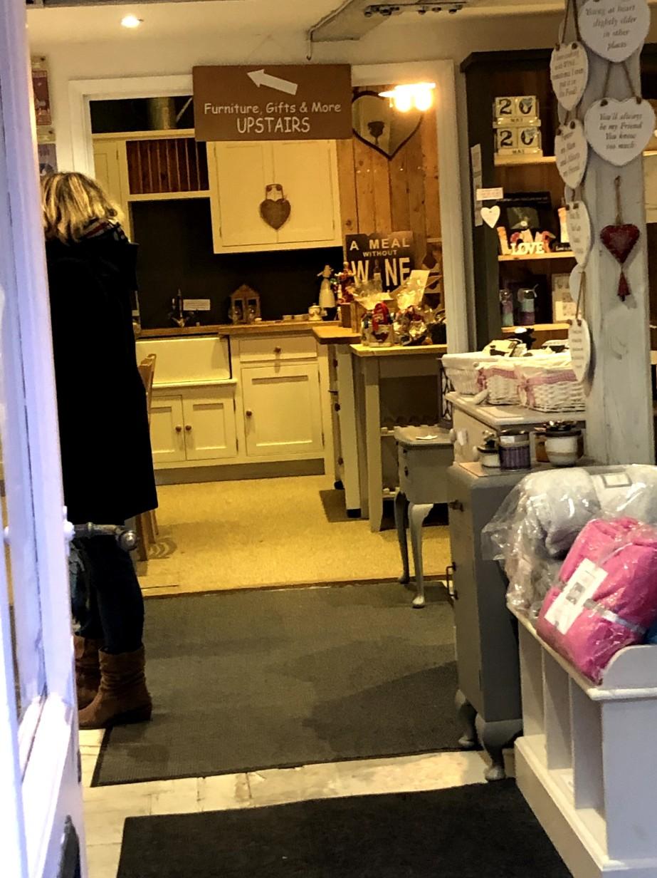 photo through the doorway of vintage furniture shop